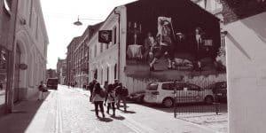 Tour group walking past the Black Box, Hill Street, Belfast